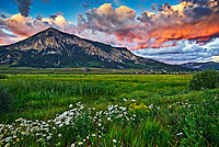 Storm clouds over Mount Crested Butte at sunset in Colorado.
