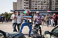 Pro-Morsi demonstrators outside a rally supporting the arrested president in Nassr City, Cairo.