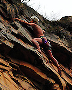 China Out - Finland Out<br /> ZHANGJIAJIE, CHINA - JANUARY 25: <br /> <br /> Naked Climber Scales 100-meter Peak<br /> <br /> Naked climber Li Tongxing makes his way up a steep cliff on way to a 100-meter-high peak in Zhangjiajie, Hunan Province of China. Li Tongxing made his way the top of 100-meter-high peak under two hours. Li reportedly took on the challenge despite protest from his wife, who jokingly told him that she would break up with him if he did it. <br /> ©Exclusivepix
