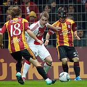 Galatasaray's Emre COLAK (R) and Ajax's Christian ERIKSEN (C) during their Friendly soccer match Galatasaray between Ajax at the Turk Telekom Arena at Arslantepe in Istanbul Turkey on Saturday 15 January 2011. Turkish soccer team Galatasaray new stadium Turk Telekom Arena opening ceremony. Photo by TURKPIX