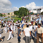 A marching band performs as part of the celebrations for Guatemalan Independence Day (15 September 2011). Groups of school students parade in a procession through the streets of Flores, starting in the Parque Central, walking through the town, and crossing the causeway into Santa Elena.