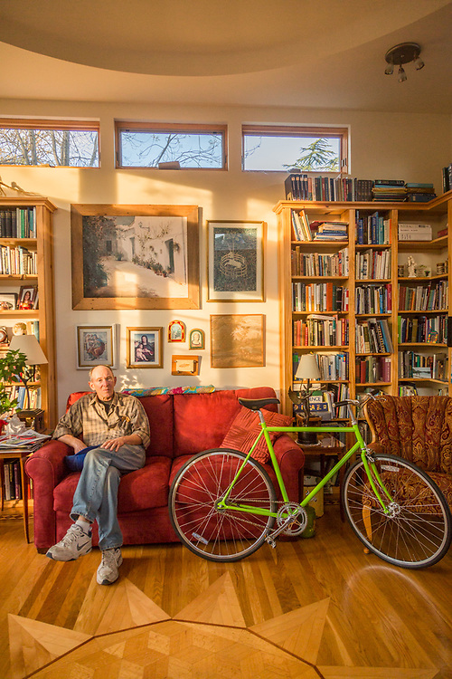 """""""I designed this room and the dome  ceiling often produces an echo.""""  -Retired wood floor craftsman Donald Williams sits in late afternoon light in the library of his home on View Road in Calistoga."""