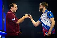 Dmitriy Gorbunov (Russia) congratulates Jason Lowe (England) during the William Hill World Darts Championship at Alexandra Palace, London, United Kingdom on 20 December 2020.