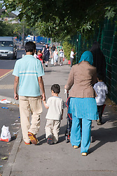 Young family walking to school