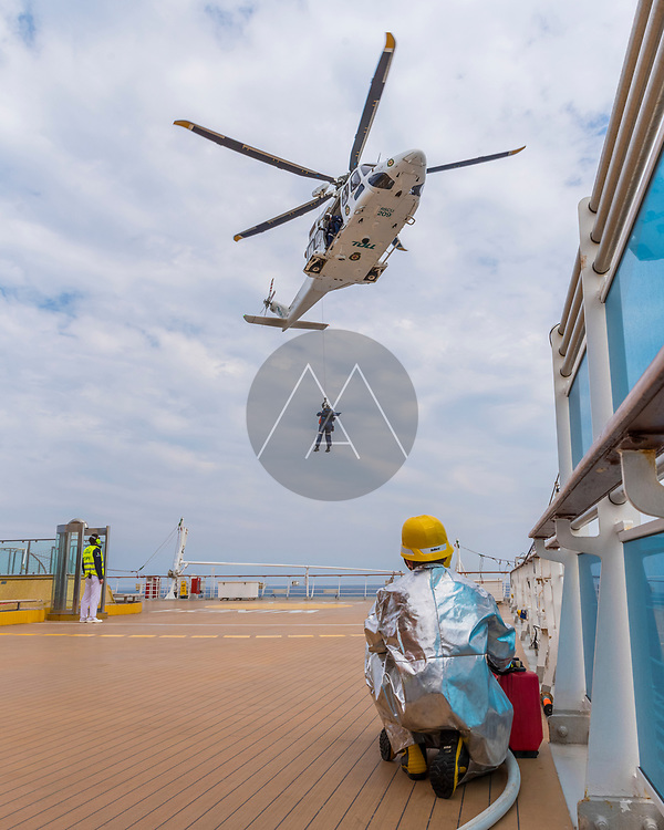 Sydney, Australia - 10 March 2019: View of cruise ship staff performing a passenger rescue with helicopter operation landing on board of a cruise vessel, Australia.