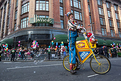 © licensed to London News Pictures. London, UK 03/11/2012. Street entertainers performing as Harrods Christmas Parade taking place outside Harrods shopping centre in London on 03/11/12. Photo credit: Tolga Akmen/LNP