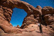 A photographer photographing Turret Arch in Arches National Park in Moab, Utah.