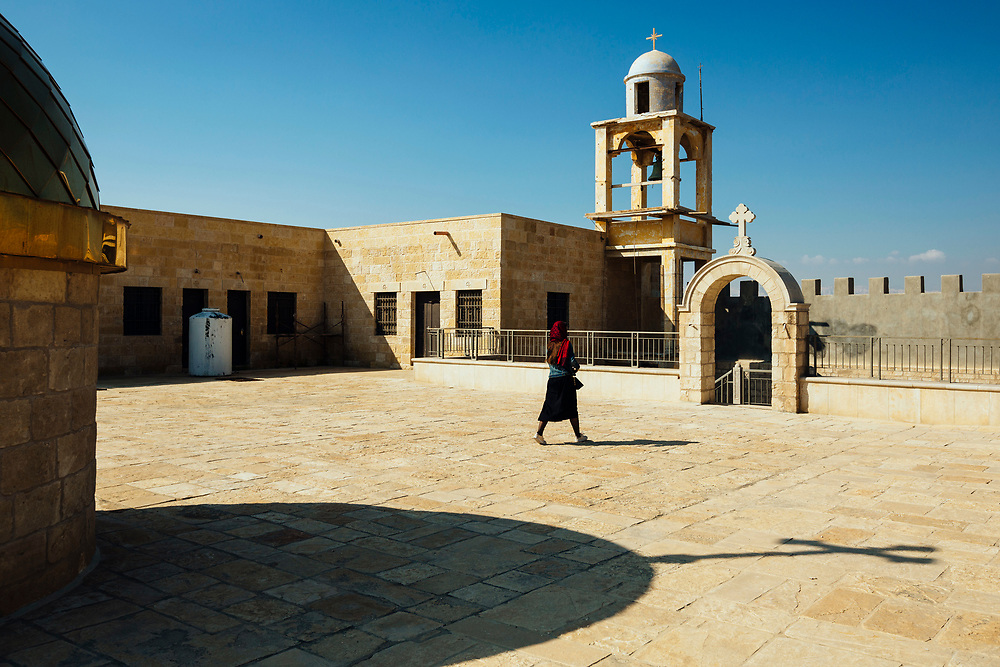 A Christian Orthodox pilgrim is seen on the rooftop of the Greek Orthodox monastery of St John the Baptist, part of Qasr el-Yahud baptismal site on the Jordan River, near the West Bank city of Jericho, on February 23, 2019.