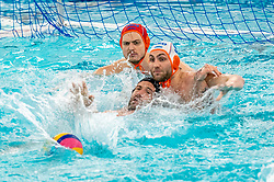 Eelco Wagenaar, Guus van IJperen of the Netherlands in action against Ugo Crousillat of France during the Olympic qualifying tournament. The Dutch water polo players are on the hunt for a starting ticket for the Olympic Games on February 17, 2021 in Rotterdam