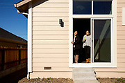 From left: Delia Perez and Alejandra Ayala check out Perez's new backyard at her home along Hopper Avenue in the Coffey Park neighborhood on Friday, Jan. 25, 2019, in Santa Rosa, Calif. The neighborhood is being rebuilt after it was destroyed in the Tubbs Fire in 2017.