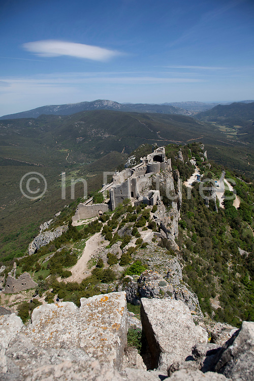 Peyrepertuse is a ruined fortress and one of the Cathar castles of the Languedoc located in the French Pyrénées in the commune of Duilhac-sous-Peyrepertuse, in the Aude département. It was associated with the Counts of Barcelona, later kings of Aragon. The name Peyrepetuse is derived from Pèirapertusa, Occitan, meaning Pierced Rock.