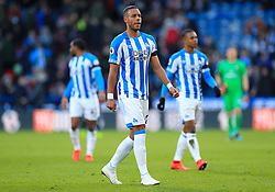 Huddersfield Town's Mathias Zanka Jorgensen (centre) leaves the pitch at half time during the Premier League match at the John Smith's Stadium, Huddersfield.