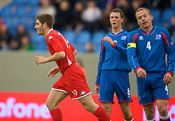REYKJAVIK, ICELAND - Wednesday, May 28, 2008: Wales' goalscorer Ched Evans celebrates after scoring on his debut against Iceland during the international friendly match at the Laugardalsvollur Stadium. (Photo by David Rawcliffe/Propaganda)