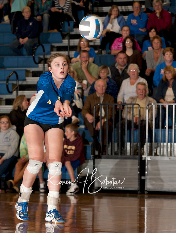 Jessa Crites bumps the ball during Wednesday nights NHIAA Division II volleyball matchup with Kennett at Gilford High School.  (Karen Bobotas/for the Laconia Daily Sun)