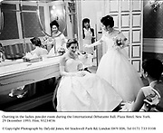 Chatting  in the ladies powder room during the International Debutante Ball. Plaza Hotel. New York. 29 December 1993. Film. 93234f36<br />
