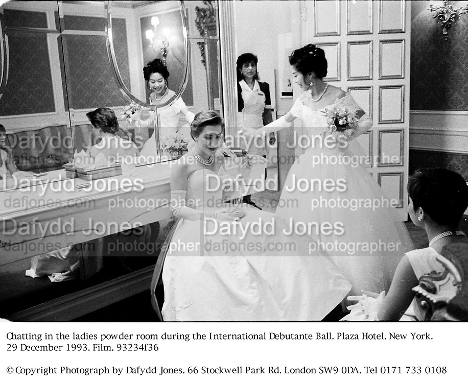 Chatting  in the ladies powder room during the International Debutante Ball. Plaza Hotel. New York. 29 December 1993. Film. 93234f36<br />© Copyright Photograph by Dafydd Jones<br />66 Stockwell Park Rd. London SW9 0DA<br />Tel 0171 733 0108