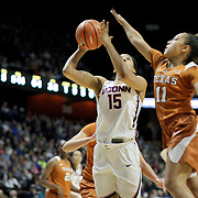 UNCASVILLE, CONNECTICUT- DECEMBER 4:  Gabby Williams #15 of the Connecticut Huskies drives to the basket defended by Brooke McCarty #11 of the Texas Longhorns during the UConn Huskies Vs Texas Longhorns, NCAA Women's Basketball game in the Jimmy V Classic on December 4th, 2016 at the Mohegan Sun Arena, Uncasville, Connecticut. (Photo by Tim Clayton/Corbis via Getty Images)