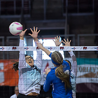 Eagles middle hitter Kariah Wilson (22), sets up to block Mikayla Bohlman (10) at the net. St. Michael's defeated Navajo Prep 3-0 at the Santa Ana Star Center in Rio Rancho on Friday.