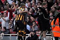 Bernard Mendy (Hull) hugs winning goalscorer Daniel Cousin (Hull) as Steve Parkin (Hull First Team Coach) tells him to get back in position. Arsenal Vs Hull City. Barclays Premier League. Emirates Stadium. London. 27/09/2008. Credit Colorsport/Garry Bowden