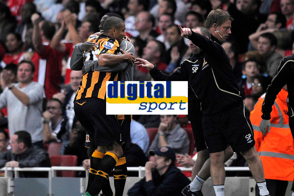 Bernard Mendy (Hull) hugs winning goalscorer Daniel Cousin (Hull) as Steve Parkin (Hull First Team Coach) tells him to get back in position. Arsenal Vs Hull City. Barclays Premier League. Emirates Stadium. London. 27/09/2008. Credit Colorsport/Garry Bowden