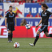 Mix Diskerud, NYCFC, kicks a flat ball back to the bench during the New York Red Bulls Vs NYCFC, MLS regular season match at Red Bull Arena, Harrison, New Jersey. USA. 10th May 2015. Photo Tim Clayton