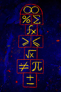 A hopscotch game drawn with glowing chalk that uses mathmatical symbols in place of numbers. Blacklight Photography.