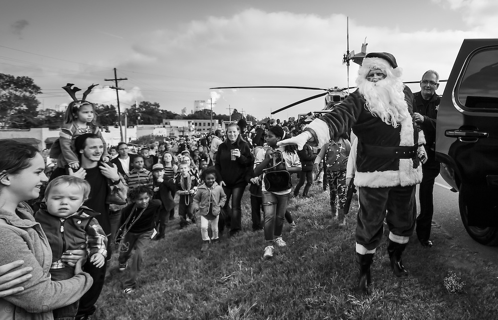 Santa Claus lands on the levee in Norco for the anual Christmas parade.