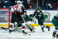 KELOWNA, BC - FEBRUARY 28:  Dustin Wolf #32 defends the net a Olen Zellweger #48 of the Everett Silvertips attempts to block a shot by Alex Swetlikoff #17 of the Kelowna Rockets at Prospera Place on February 28, 2020 in Kelowna, Canada. (Photo by Marissa Baecker/Shoot the Breeze)