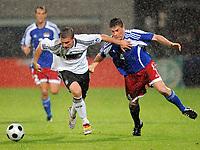 Fotball, 6. september 2008 , VM-kvalifisering , Liechtenstein - Tyskland<br /> vv.l. Fabio D'Elia Liechtenstein , Lukas Podolski<br /> Norway only