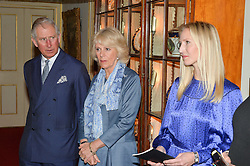 Thursday 26th March 2015, The Elephant Family charity and Quintessentially Foundation announced the launch of 'Travels To My Elephant' – a once-in-a-lifetime rickshaw race taking place in India in November 2015. The official launch of the venture took place at Clarence House at an exclusive reception hosted by TRH The Prince of Wales and The Duchess of Cornwall,  joint patrons of Elephant Family.<br /> Picture Shows:- The Prince of Wales and the Duchess of Cornwall.