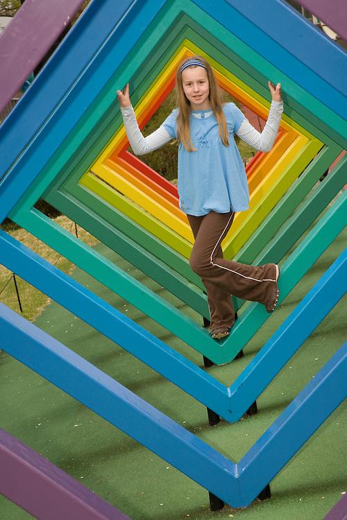 Asia, Japan, Kanagawa prefecture, Hakone, Open Air Museum, girl (age 10) climbing on rainbow sculpture MR