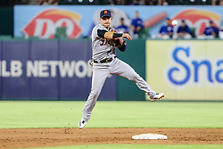 May 7, 2018 - Arlington, TX, U.S. - ARLINGTON, TX - MAY 07: Detroit Tigers shortstop Jose Iglesias (1) fumbles the baseball and makes an errant throw to first base during the game between the Texas Rangers and the Detroit Tigers on May 07, 2018 at Globe Life Park in Arlington, Texas. Texas defeats Detroit 7-6. (Photo by Matthew Pearce/Icon Sportswire) (Credit Image: © Matthew Pearce/Icon SMI via ZUMA Press)