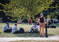 © Licensed to London News Pictures. 22/09/2020. London, UK. Groups of office workers in St James's Park enjoy the last rays of sun before a break in the weather tomorrow with temperatures down by 10c with wind and rain forecast. Prime Minister Boris Johnson has announced further tougher Covid restrictions with a 10pm curfew on pubs and restaurants and a £200 fine for not wearing a mask and for breaking the rule of six as a spike in coronavirus rates continues across the country. Photo credit: Alex Lentati/LNP