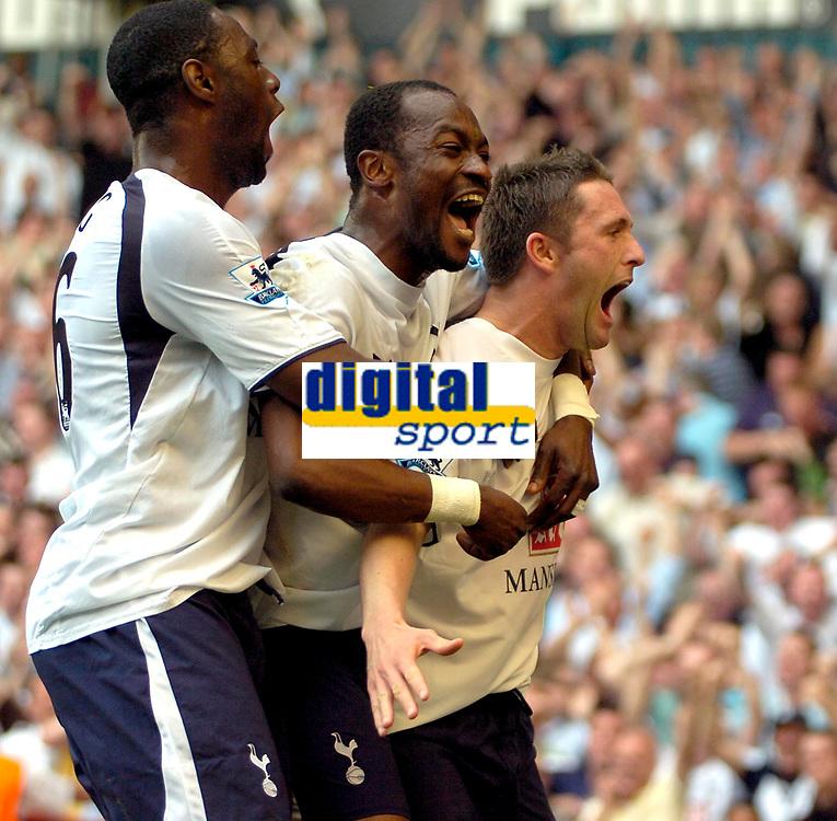Photo: Ed Godden/Sportsbeat Images.<br /> Tottenham Hotspur v Arsenal. The Barclays Premiership. 21/04/2007. Spurs' Robbie Keane celebrates scoring the opening goal with team mate Didier Zokora (centre) and Ledley King (L).