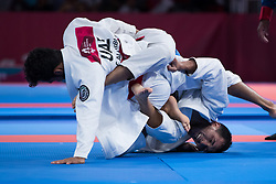 JAKARTA, Aug. 24, 2018  Torokan Bagynbai Uulu (R) of Kyrgyzstan competes against Talib Alkirbi of the United Arab Emirates (UAE) during the Ju-Jitsu Newaza Men's -69 kg Gold Medal contest at the 18th Asian Games in Jakarta, Indonesia, Aug. 24, 2018. (Credit Image: © Zhu Wei/Xinhua via ZUMA Wire)