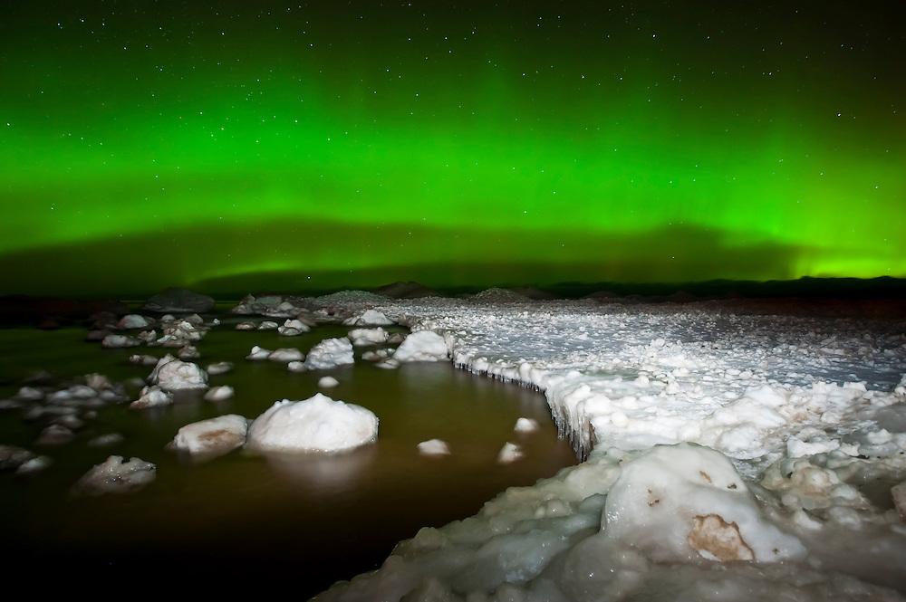 Northern Lights aurora borealis over Lake Superior at Au Train Michigan in Michigan's Upper Peninsula in winter.