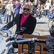 NLD/Amsterdam/20140416 - Presentatie L' Homo 2014, maik de Boer op de scooter