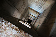 An elevator shaft at the abandoned Ljubljanska Banka Tower in Mostar, Bosnia and Herzegovina. The building was used as a sniper tower by Croat forces during the Bosnian war and has been abandoned ever since.