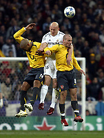 Photo: Chris Ratcliffe.<br />Real Madrid v Arsenal. UEFA Champions League. 2nd Round, 1st Leg. 21/02/2006.<br />Thomas Graveson of Real Madrid goes up for a header with Thierry Henry and Freddie Ljungberg of Arsenal.