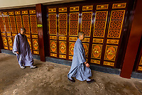 Buddhist nuns walking through the Yuantong Temple is the most famous Buddhist temple in Kunming, Yunnan Province, China. It was first built in the late 8th and early 9th century, the time of the Nanzhao Kingdom in the Tang dynasty.
