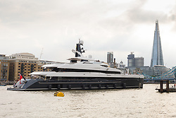 © Licensed to London News Pictures. 04/07/2018. London, UK.  The new 243 feet long superyacht, Elandess passing Butlers Wharf and the shard as it arrives in London for the first time ever on the River Thames and moors at HMS President, the Royal Navy Reserve Unit next to St Katharine Docks and Tower Bridge this evening. Elandess was built at the Abeking and Rasmussen shipyard in Germany, launched in May 2018 and has just completed sea trials ahead of its London visit. Elandess has an axe-bow, dark hull and low-slung superstructure. There are a variety of entertaining communal spaces, from the 8 x 2.5-metre superyacht swimming poollocated on the massive sun deckto the Nemo Loungewith portholesbelow the waterline and an observation lounge on the upper deck. Guest accommodation includes six staterooms, including the master suitewhich is placed forward on the main deck with an observation lounge directly above on the upper deck.  Photo credit: Vickie Flores/LNP