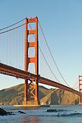 Surfers Under Golden Gate Bridge at Fort Point - San Francisco - California