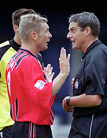 Peter Grant (Bournemouth) argues with referee R. Beeby. Colchester United v AFC Bournemouth. League Division Two, 2/9/00. Credit Colorsport / Nick Kidd.