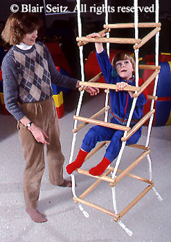 Medical , Occupational Therapy for Children, Therapy Apparatus, Therapist with Child in Climbing Ropes