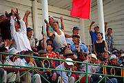 Zuunmod, Mongolia, July 2003..Competitors and spectators at the Mongolian Wrestling contests in the Llama Naadam. Spectators try to catch lucky sweets thrown to the crowd by a winning wrestler.