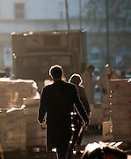 A man walks through Smithfields Fish market in the morning, London, UK