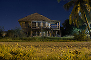 Night panorama of a wooden home in Punta Gorda, Toledo, Belize. January 27, 2013.