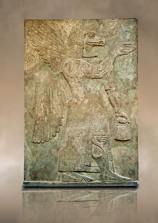 Assyrian relief sculpture panel of a protective spirit with an eagles Head from Nimrud, Iraq.  The spirit is holding a symbolic fir cone and is sprinkling holy water from the bucket it is holding. The rosette bracelet worn around the wrist symbolises divine power. 865-860 B.C North West Palace, Room G, panelled d1. ref: British Museum Assyrian  Archaeological exhibit WA 124576 .<br /> <br /> If you prefer to buy from our ALAMY PHOTO LIBRARY  Collection visit : https://www.alamy.com/portfolio/paul-williams-funkystock/ancient-assyria-antiquities.html  Refine search by adding background colour, place, subject, museum etc into the LOWER SEARCH WITHIN GALLERY box to <br /> <br /> Visit our ANCIENT ASSYRIAN PHOTO COLLECTIONS for more photos to download or buy as wall art prints https://funkystock.photoshelter.com/gallery-collection/Ancient-Assyrian-Art-Artefacts-Antiquities-Historic-Sites-Pictures-Images-of/C0000cjRqQyJjLag