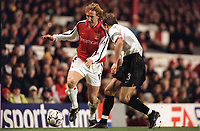 Ray Parlour (Arsenal) Michael Gray (Sunderland). Arsenal 2:2 Sunderland. FA Carling Premiership, 30/12/2000. Credit Colorsport / Stuart MacFarlane.