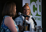"""Reporter Lindsay Christians and chef Nyanyika Banda talk during the live recording of the """"Corner Table Podcast"""" at Old Sugar Distillery in Madison, Wisconsin, Tuesday, June 18, 2019."""